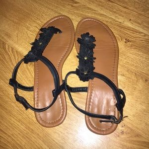 Brown sandals with black flowers